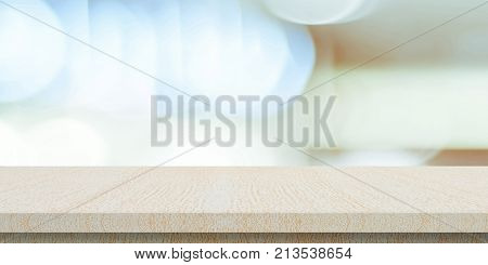 Empty wood table over blur store background banner tabletop shelf counter design for product and food display montage