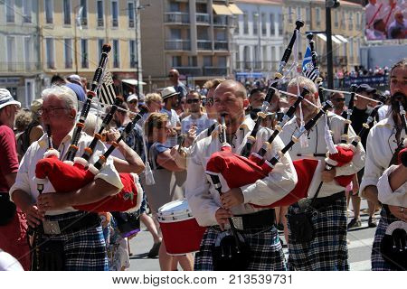 Sete, Herault, France  - Aug 21 2017: Kilted Bagpipers Of The Traditional French Celtic Band