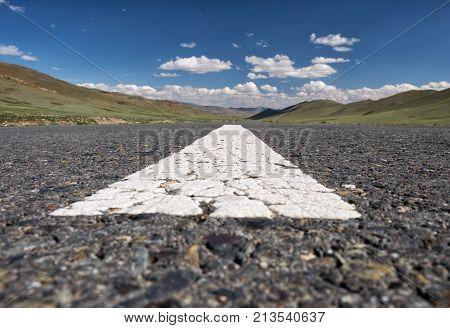 Wide-angle Shot Of Empty Road Markings On Asphalt In Mongolia Between Mongolian Towns Tsagaannuur An