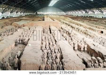 XI'AN SHAANXI PROVINCE CHINA - OCTOBER 17 2017: The Terracotta Warriors of the famous Terracotta Army inside the Qin Shi Huang Mausoleum of the First Emperor of China.