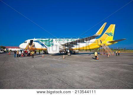 PUERTO PRINCESA ,PHILIPPINES - MARCH 23. 2016: Tourists embark on the Cebu Pacific aircraft at Puerto Princesa Airport on March 23, 2016.Philippines,Main hub is at Ninoy Aquino Airport