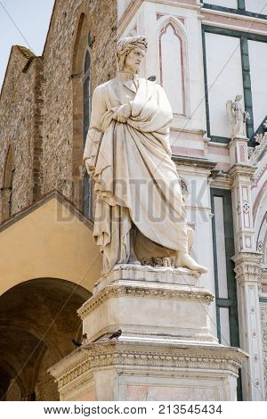 Ancient statue of Dante Alighieri in the old city of Florence, Italy