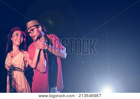 new year party holidays celebration nightlife and people concept - Young couple having fun dancing at a party.