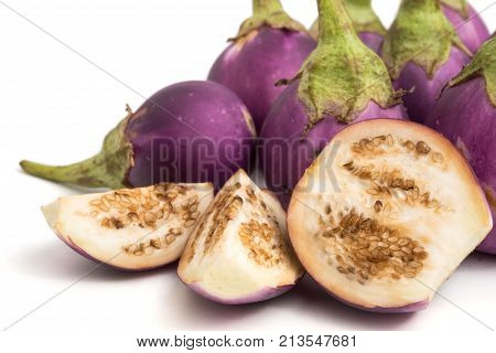 Fresh Purple eggplants on a white background.