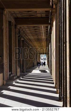 Visitors In Passage On Museum Island In Berlin