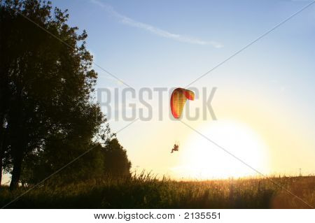 Parachutist In Front Of Sun