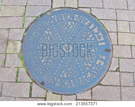 Chiba, Japan - February 26, 2017: Manhole cover of Kamagaya city in Chiba prefecture, Japan. Kamagaya city declare to non-nuclear peaceful city, so they engrave Green and Clean on their manhole cover.