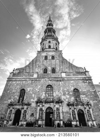 Riga, Latvia - August 22, 2017: View on ancient Saint Peter's Church, Riga, Latvia. First mention of the St. Peter's Church is in records dating to 1209. Saint Peter's Church full view. Black and white.