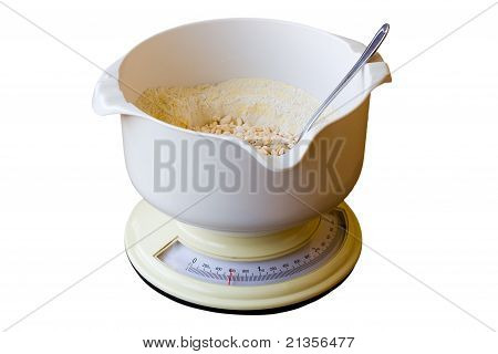 Kitchen Scale With Flour Isolated On White Background