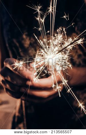 Hand Holding A Burning Sparkler Firework Bengal Light. Space For Text. Burning Sparkler Closeup In F