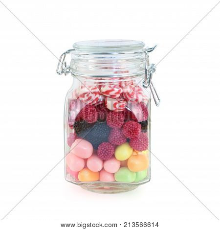 Glass jar with many bright sweet candies isolated on white background