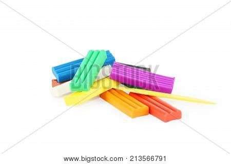 Bright soft plasticine and plastic knife isolated on white background
