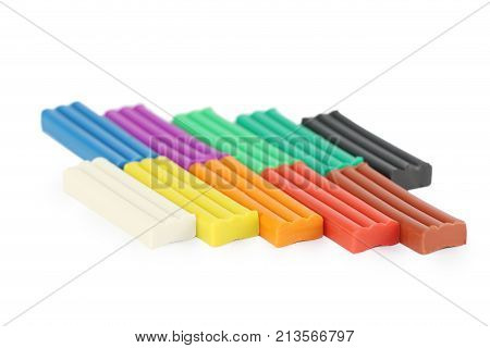 Bright soft plasticine isolated on white background - ten colors