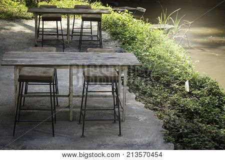 Weathered old outdoors table and chairs set stock photo