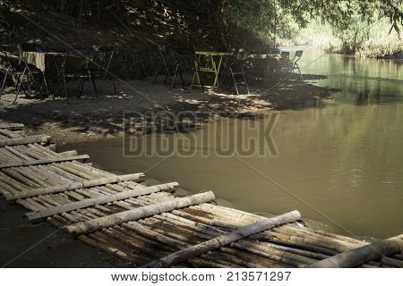 Bamboo bridge over the creek stock photo