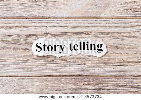 story telling of the word on paper. concept. Words of story telling on a wooden background.