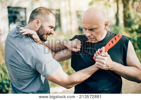 Self Defense Disarming Technique Against Threat And Knife Attack
