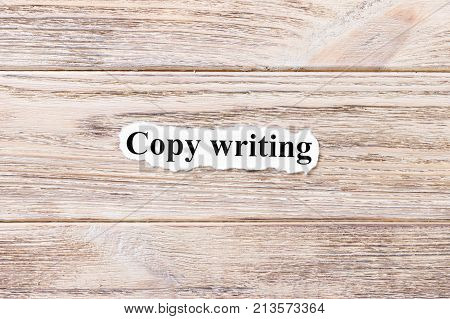 Copy writing of the word on paper. concept. Words of Copy writing on a wooden background.