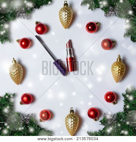 Watch from New Year's toys with arrows from lipstick and mascara. Five minutes to twelve. The last preparations for the meeting of the new year. Time for make-up