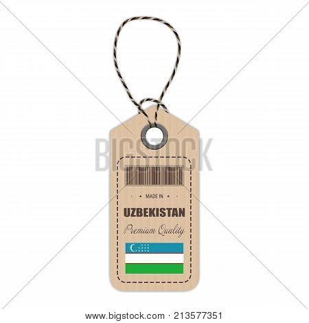 Hang Tag Made In Uzbekistan With Flag Icon Isolated On A White Background. Vector Illustration. Made In Badge. Business Concept. Buy products made in Uzbekistan. Use For Brochures, Printed Materials, Logos, Independence Day