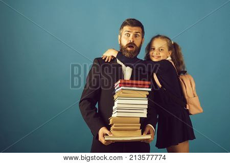 Father And Schoolgirl With Surprised And Smiling Faces