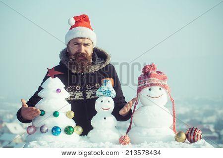 Santa Man Feeling Indignant With Snowy Sculptures