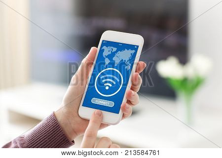 Female hands holding phone with application to search for free wi-fi on screen in room home