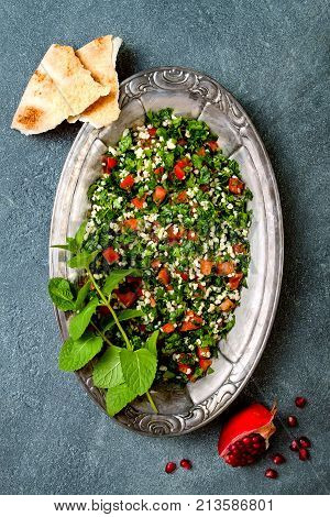 Middle Eastern traditional salad Tabbouleh. Authentic arab cuisine. Top view flat lay overhead