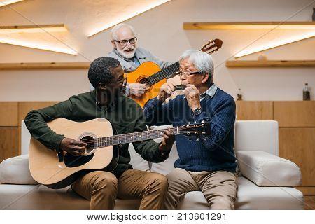 Senior Friends Playing Music