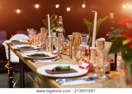 Decorated Christmas Holiday Table Ready For Dinner. Beautifully Decorated Table Set With Candles, Sp