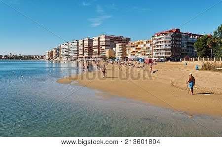 Torrevieja Spain - October 20 2017: Acequion beach in the Torrevieja resort city. Torrevieja is a Mediterranean city popular travel destination for tourists. Costa Blanca. Province of Alicante. Spain