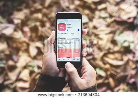 CHIANG MAI THAILAND - Nov 102017: Apple iPhone 6s with Airbnb application on the screen. Airbnb is a website for people to list find and rent lodging.