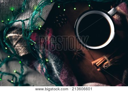 cup with herlands, Christmas and New Year, Cozy still life details in the living room. composition with Cup