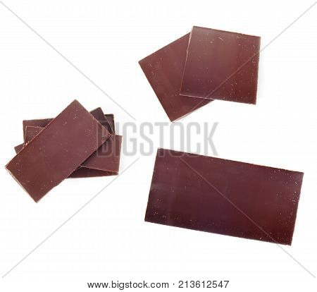 chocolate pieces isolated on white background .