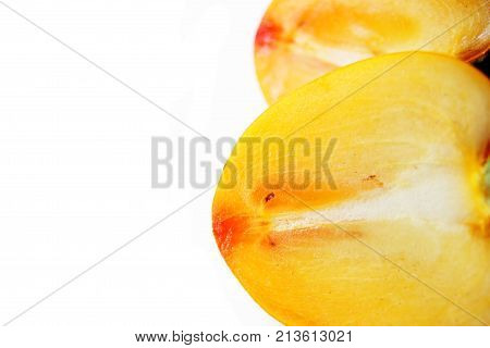 ripe sweet persimmon isolated on white background