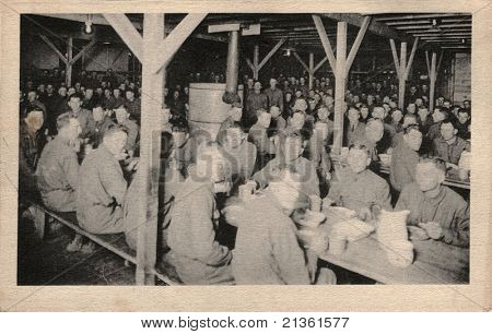 CHILLICOTHE, OHIO - CIRCA 1900: Boys at Mess -  Early 1900 postcard depicting US Army soldiers in mess hall at Camp Sherman, Chillicothe, Ohio during WWI circa 1900