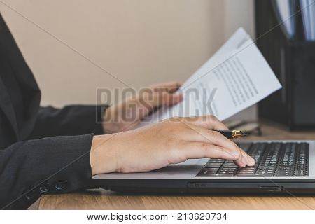 Business Woman Working At Office With Laptop And Documents On Her Desk, Reading And Typing, Business