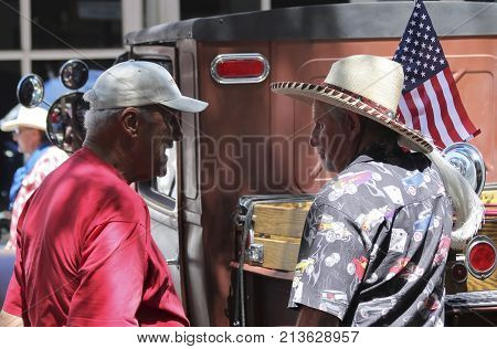 SANTA FE, NEW MEXICO, JULY 4. The Plaza on July 4, 2017, in Santa Fe, New Mexico. A Pair of Old Timers Talk Cars at a Vintage Car Show a Tradition on the Fourth of July in Santa Fe New Mexico.