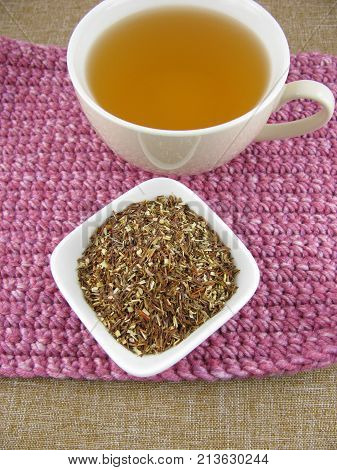 Fresh brewed green rooibos tea in a cup