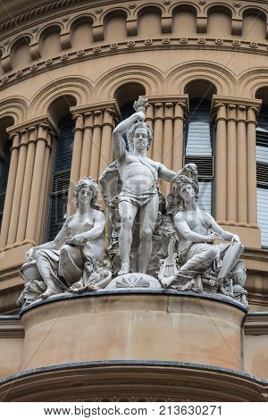 Sydney Australia - March 25 2017: Closeup of allegorical group frieze and statues on facade of historic Victoria shopping mall on York Street shows youth science and art.