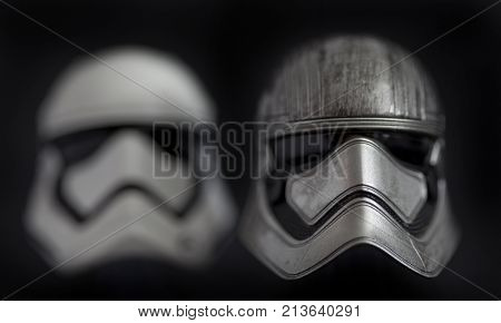 Studio portrait of Captain Phasma and First Order Stormtrooper helmets from Star Wars The Last Jedi
