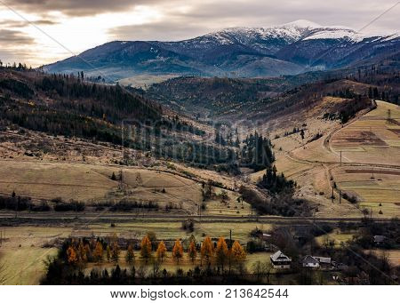 Rural Valley At The Foot Of Snowy Mountain