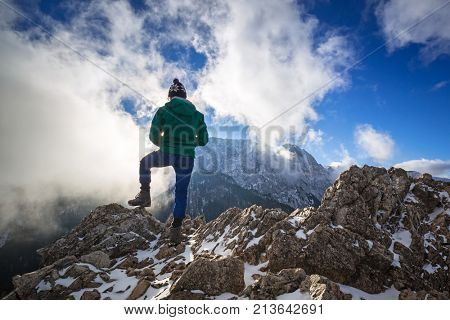 Hiker standing on the top of a hill in Tatra mountains, Poland