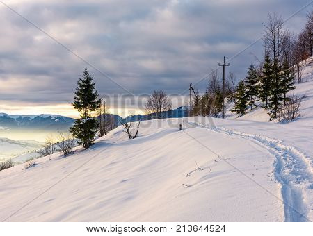 Rural Footpath Through Snowy Hillside