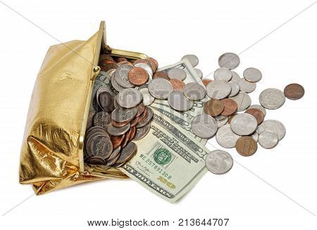 Horizontal shot of an open gold metallic coin purse laying on its side with cash and coins spilling out of it on a white background.
