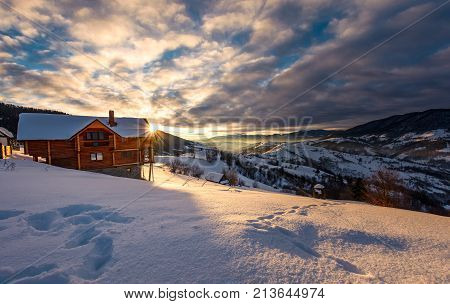 Wooden Chalet In Deep Snow At Sunrise