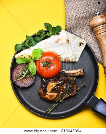 Pork Or Lamb Ribs With Decor On Frying Pan