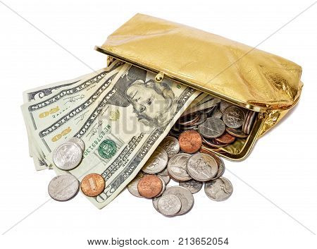 Horizontal shot of an open gold metallic coin purse laying on its side with fives, twenties, and coins spilling out of it on a white background.