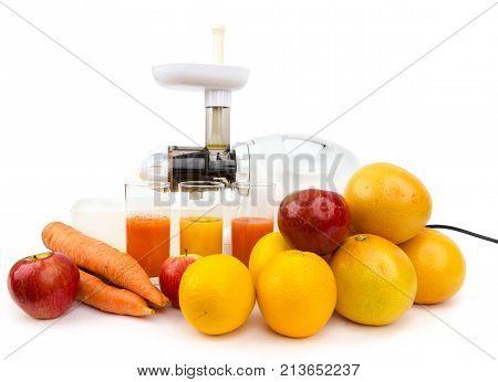 Making fresh fruit juice using juicer on the white background