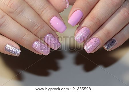 Manicured Nails With Pink Nail Polish.